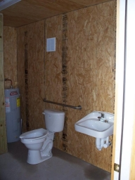 Handicap accessible bathroom with shower.